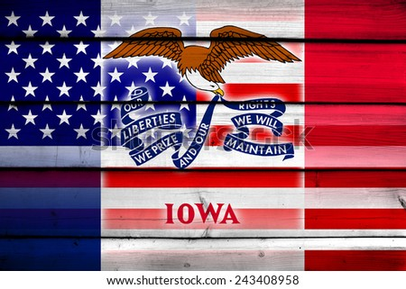 USA and Iowa State Flag on wood background