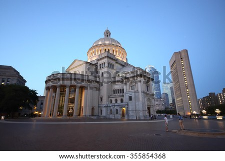 USA, BOSTON - SEP 06, 2014: Mary Baker Eddy Library and Christian Science Mother Church near pond at autumn evening. - stock photo