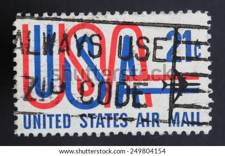 USA - CA. 1968: United States postage stamp in the value of 20c used for overseas air mail deliveries showing the letters USA in red, white and blue and the print United States Air Mail - stock photo