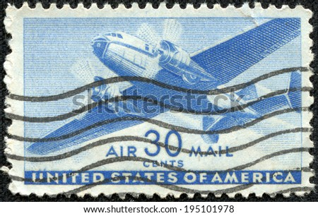 USA-CIRCA 1941: A 30 cent United States Airmail postage stamp shows image of a twin-engined transport plane, circa 1941. - stock photo