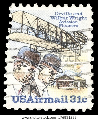USA-CIRCA 1978: A 31 cent United States Airmail postage stamp, shows image of pioneer aviators the Wright Brothers, commemorating the first successful powered flight, circa 1978. - stock photo