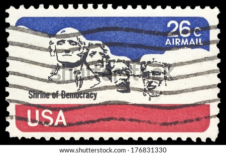 USA-CIRCA 1974: A 21 cent US Airmail  stamp, shows image of Mount Rushmore with  iconic faces of  , George Washington, Thomas Jefferson, Theodore Roosevelt, and Abraham Lincoln, circa 1974. - stock photo
