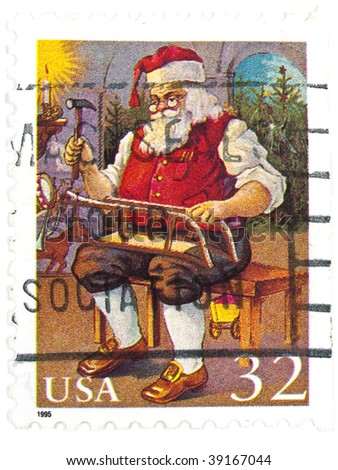 USA - CIRCA 1995: A 32 cents stamps printed in USA showing Santa building toys, circa 1995