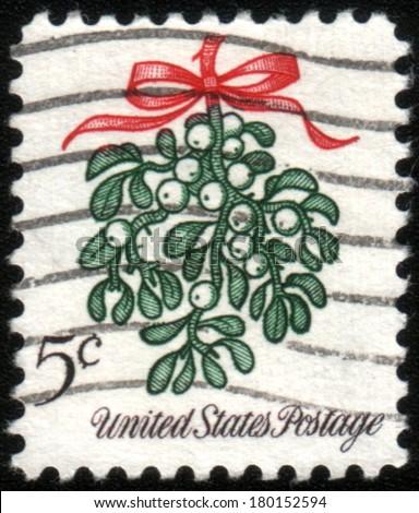USA - CIRCA 1964: A Christmas postage stamp show mistletoe, circa 1964 - stock photo