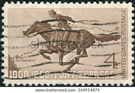 USA - CIRCA 1960: A postage stamp printed in USA, Pony Express Centennial Issue, shows Pony Express Rider, circa 1960 - stock photo