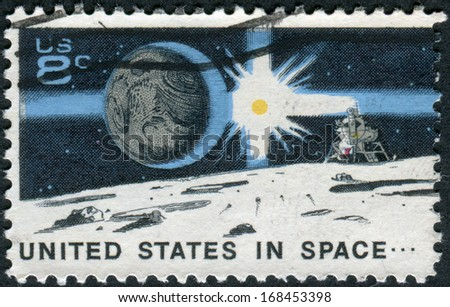 USA - CIRCA 1971: A postage stamp printed in USA, Space Achievement Decade Issue, shows the Earth, Sun, Landing Craft on Moon, circa 1971 - stock photo
