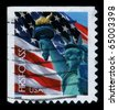 USA-CIRCA 2006: A stamp dedicated to the The Statue of Liberty (Liberty Enlightening the World  is a colossal neoclassical sculpture on Liberty Island in New York Harbor, circa 2006. - stock photo