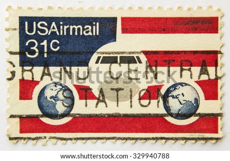 USA - CIRCA 1985: A stamp printed in the USA showing airplane at the US flag background, circa 1985. - stock photo