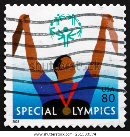 USA - CIRCA 2003: a stamp printed in the USA shows Athlete with Medal, Special Olympics, Sports Organization for Children and Adults with Intellectual Disabilities, circa 2003 - stock photo