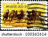 USA - CIRCA 1974 : A stamp printed in the USA shows Horse Racing, circa 1974 - stock photo