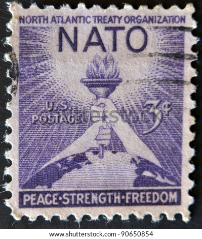 USA - CIRCA 1952 : A stamp printed in the USA shows North Atlantic Treaty Organization (NATO), Peace, Strenght, Freedom, circa 1952