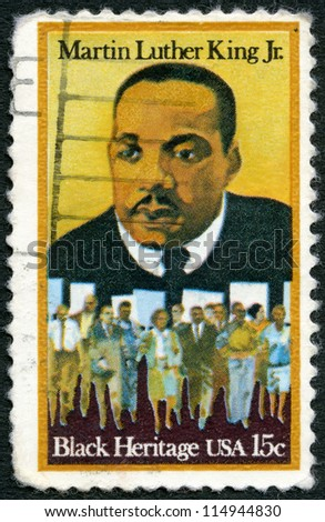 USA - CIRCA 1979: A stamp printed in United States of America shows Martin Luther King Jr. (1929 - 1968) and civil rights marchers, Black heritage, circa 1979 - stock photo