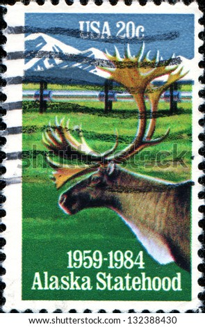 USA - CIRCA 19: A stamp printed in United States of America shows Moose and mountains, 1959-1984, Alaska Statehood, circa 1984 - stock photo