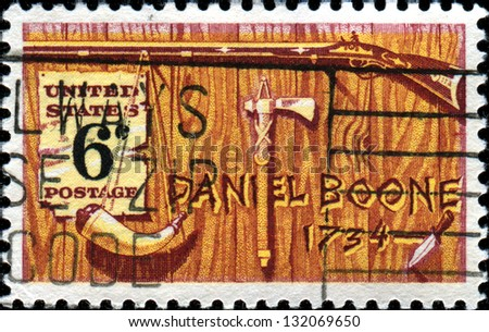 USA -CIRCA 1974: A stamp printed in United States of America shows Pennsylvania riffle, powder horn, tomahwk and knife, honoring Daniel Boone a frontiersman and trapper, Circa 1974 - stock photo