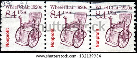 USA -CIRCA 1988: A stamp printed in United States of America shows Wheel Chair 1920s, Circa 1988 - stock photo