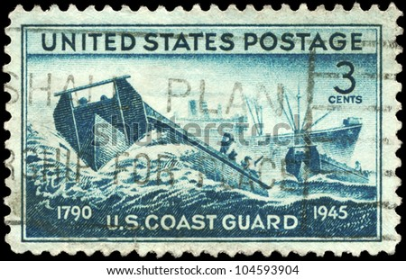 USA - CIRCA 1945: A Stamp printed in USA shows the Coast Guard landing Craft and supply Ship, achievements of the US Coast Guard in WWII, circa 1945