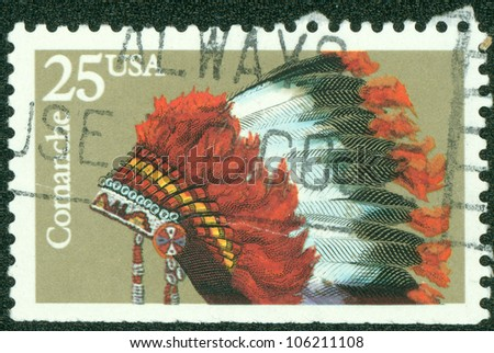 USA - CIRCA 1990: A stamp printed in USA shows the Indian Headdresses of the tribe Comanche, series, circa 1990 - stock photo