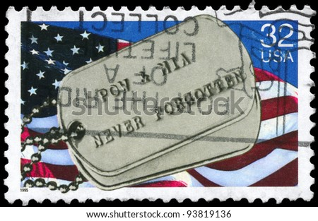 "USA - CIRCA 1995: A Stamp printed in USA shows the US Flag and military Badge, with the inscription ""Prisoners of War & Missing in Action never forgotten"", circa 1995 - stock photo"