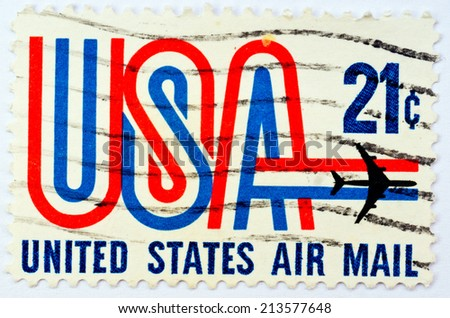 USA - CIRCA 1968: A Stamp printed in USA shows the USA inscription and Jet, symbols of American airmail , circa 1968 - stock photo