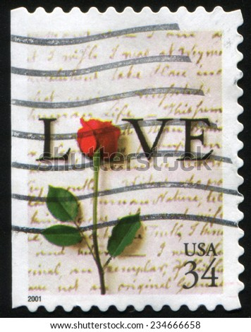 "USA - CIRCA 2001: Postage stamp printed in the United States shows The word ""Love"" and a red rose on the background of the letters written by hand., circa 2001 - stock photo"