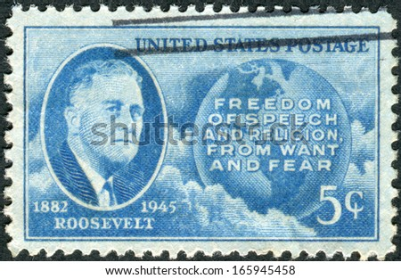 USA - CIRCA 1945: Postage stamp printed in the USA, shows a portrait of 32th President of the United States, Franklin Delano Roosevelt, Globe and Four Freedoms, circa 1945 - stock photo