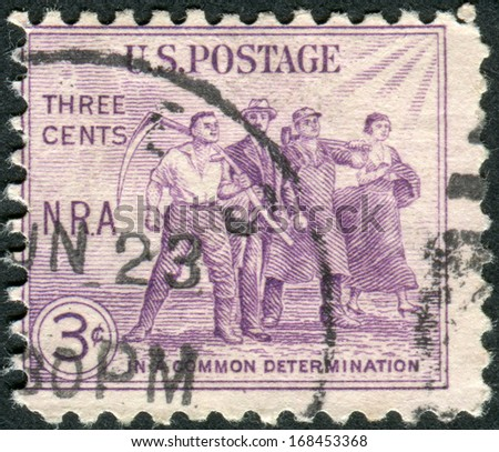 USA - CIRCA 1933: Postage stamp printed in USA, National Recovery Act Issue, shows Group of Workers, circa 1933 - stock photo