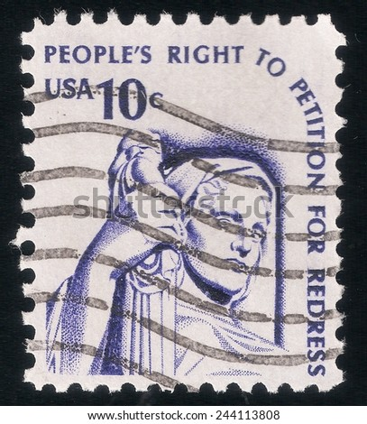 USA - CIRCA 1977: postage stamp printed in USA shows a picture of Goddess of Justice in reference to the rights and freedoms of the american people, circa 1977 - stock photo