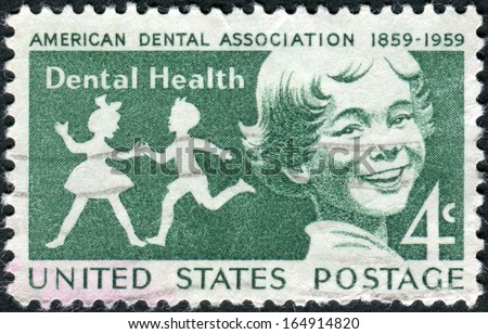 USA - CIRCA 1959: Postage stamps printed in USA, Dental Health Issue, Publicizing dental health and centenary of the American Dental Association, shows children, circa 1959 - stock photo