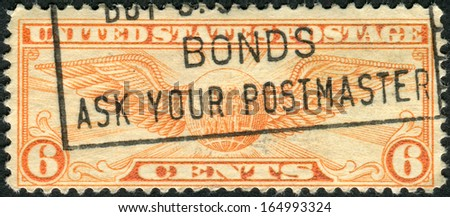 USA - CIRCA 1934: Postage stamps printed in USA, shows the pilot's badge, Winged Globe, circa 1934 - stock photo
