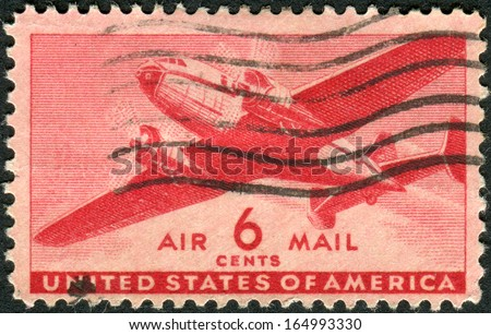 USA - CIRCA 1941: Postage stamps printed in USA, shows Twin-Motored Transport Plane, circa 1941 - stock photo