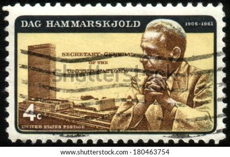 USA - CIRCA 1962: Postage stamps printed in USA, shows UN Headquarters & Dag Hammarskjold, UN General Secretaire, circa 1962 - stock photo