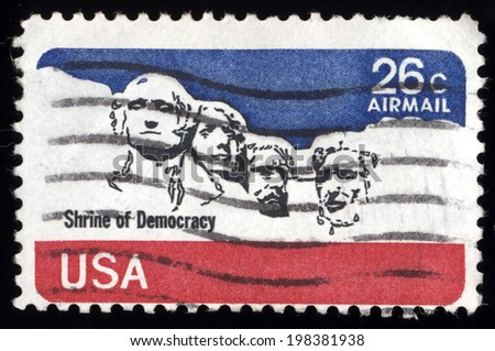 USA - CIRCA 1980's: A post stamp printed in USA shows national memorial. Stone Sculptures of George Washington, Thomas Jefferson, Theodore Roosevelt, and Abraham Lincoln, circa 1980's  - stock photo