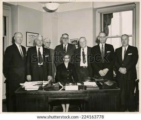USA- CIRCA 1950s: Vintage photo shows group portrait offfice staff.   - stock photo
