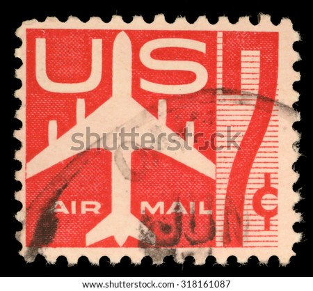 USA - CIRCA 1960: United States postage stamp in the value of 7c used for overseas air mail deliveries showing air mail symbols and the print Air Mail, circa 1960