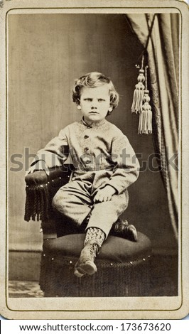 USA - CONNECTICUT - CIRCA 1875 - A vintage Cartes de visite photo of a little boy. The boy is sitting with one arm on the side of the chair. A photo from the Civil War Victorian era. CIRCA 1875 - stock photo