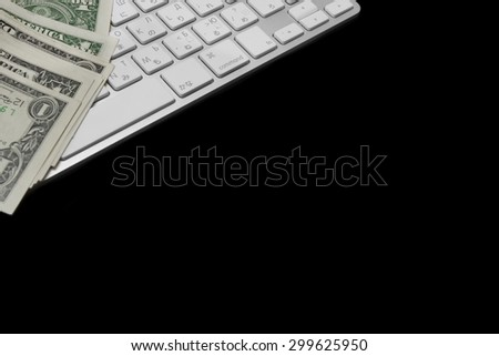 USA Dollar Bills And Wireless Keyboard Isolated On Black Background - stock photo