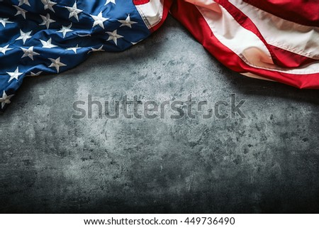 USA flag. American flag. American flag freely lying on concrete background. Close-up Studio shot. Toned Photo. - stock photo