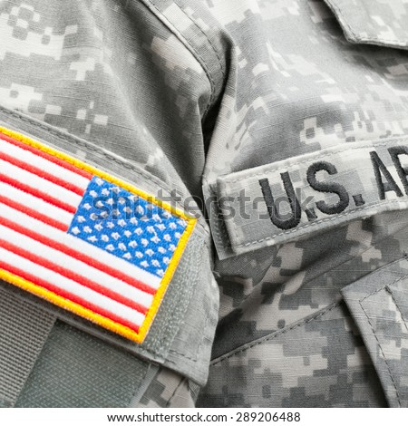 USA flag and U.S. Army patch on military uniform - stock photo