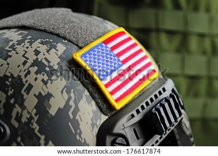 USA flag on a modern military helmet close-up. Selective focus. - stock photo
