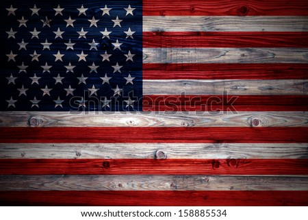 USA flag on a weathered natural wooden wall close-up - stock photo