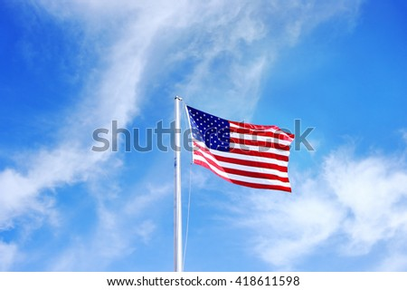 USA flag on blue sky - stock photo