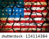 USA flag on cracked earth - stock photo
