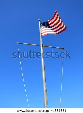USA flag on mast visible blue sky,outdoor  Photo taken on October 2009