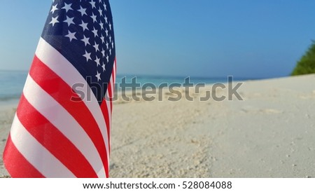USA flag on the beach and blue sky