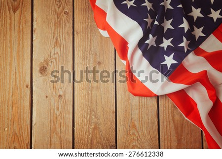 USA flag on wooden background. 4th of july celebration - stock photo
