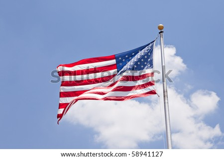 USA flag over blue sky