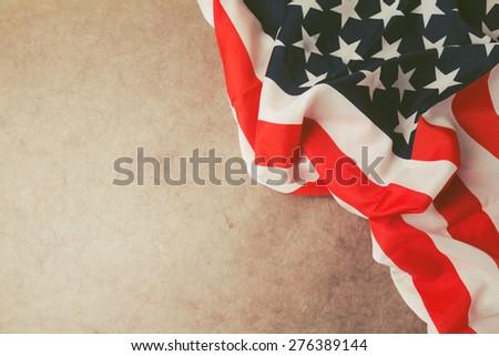 USA flag over vintage paper with copy space. 4th of july background - stock photo