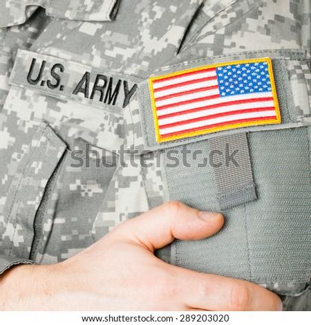USA flag shoulder patch on military uniform - studio shot - stock photo