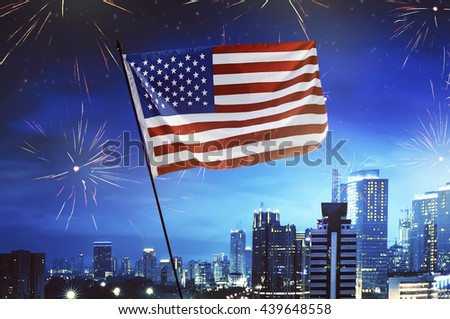 USA flag with city and fireworks background