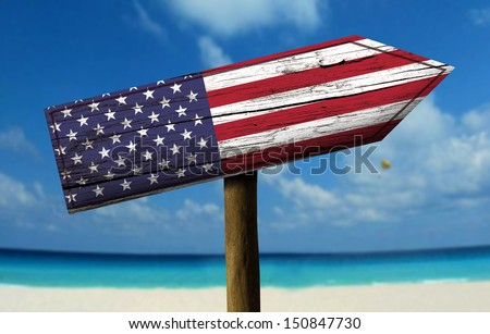 USA flag wooden sign with a beach on background - Europe - stock photo